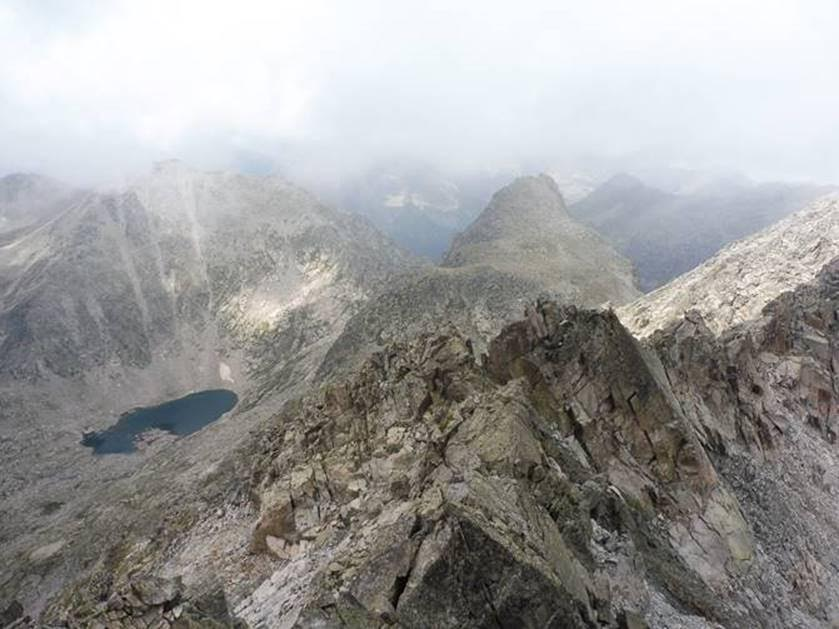 View from the summit of Comaloforno, the only col across the massif is barely 1m wide - © Rupert de Borchgrave