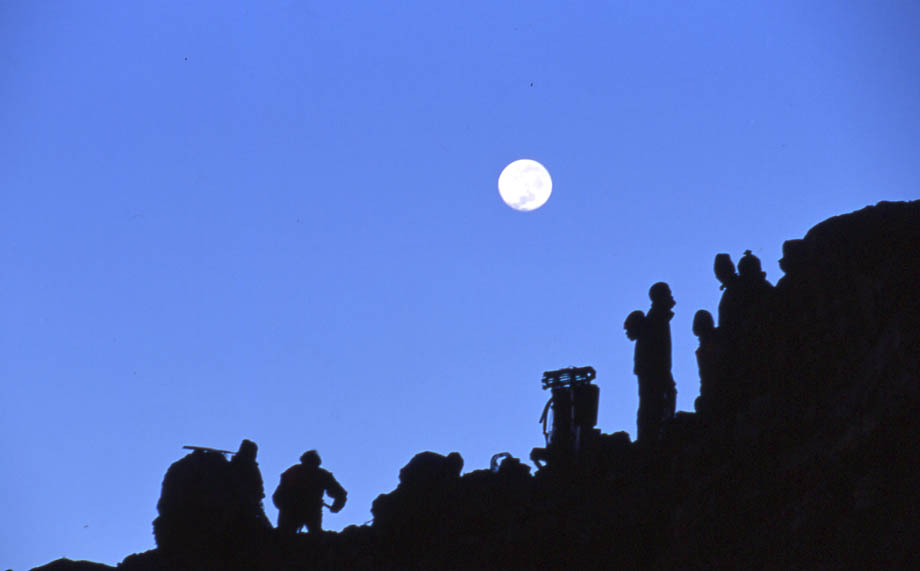 Porters and Film Crew - waiting for 1st light at Arrow Glacier Camp (15,500ft). Hoping to beat the mists - © Arabella Cecil