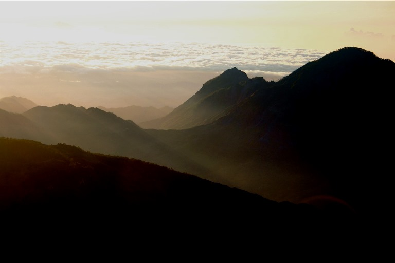 Mountains seen from Mt. Ramelau at dawn - © kate dixon flickr user