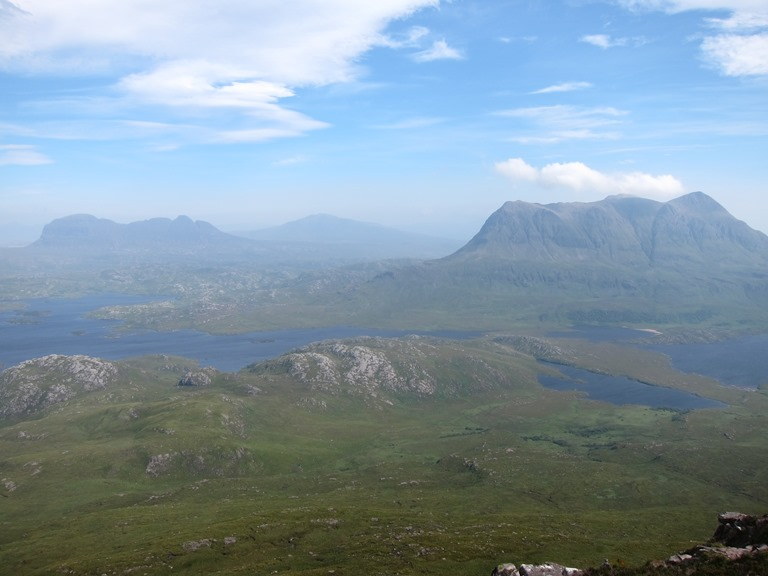 Assynt Peninsula: Suilven (L) and Cul Mor from Stac Pollaidh, hazy day - © William Mackesy