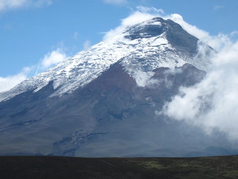 Avenue of the Volcanoes: Cotopaxi behind lower Ruminahui ridge - © William Mackesy