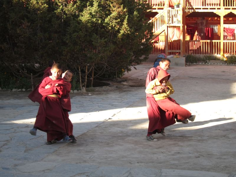 Boy monks spinning each other - © William Mackesy