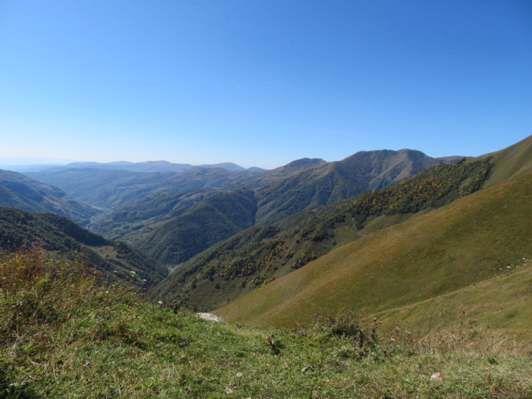 Greater Caucasus Mountains: Into South Ossetia from high ridge, Lomissa Chapel