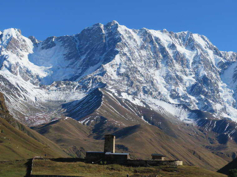 Greater Caucasus Mountains: Ushguli, Lamaria church in front of peaks