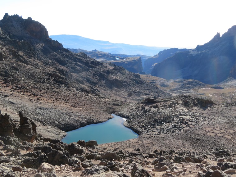 Mount Kenya: Down onto Harris Tarn with top of Gorges Valley in distance - © William Mackesy