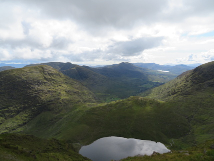 Ireland's SW Peninsulas: Reeks, south-west  down Iveragh from saddle below Carrauntoohil - © William Mackesy