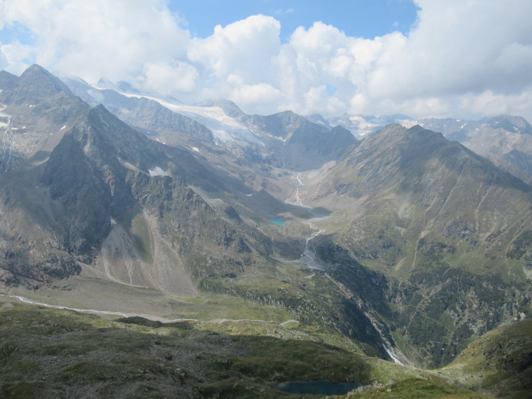 Above Nurenberger Hut; Mairspitze, Wilder Freiger: Huge bowl, Sulzenau Hut below lake, from Mairspitze - © William Mackesy