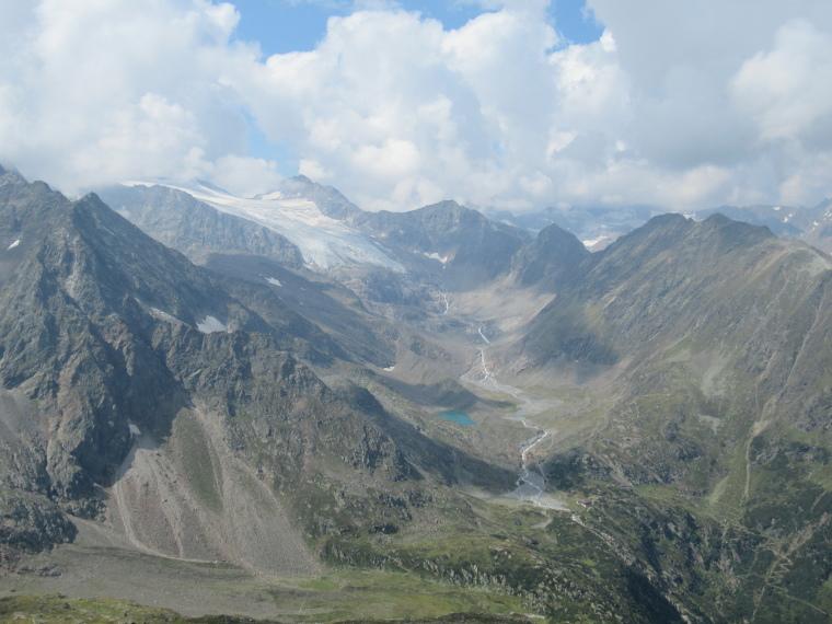 Around the Sulzenau Hut : Sulzenau Hut, bottom right; glacier and high border ridge behind - © William Mackesy