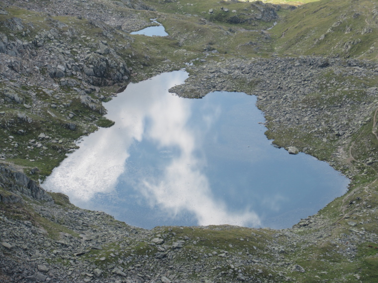 Path beside sky-reflecting tarn, above Sulzenau Hut - © William Mackesy