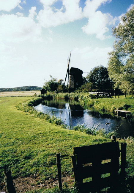 Netherlands North, Greater Friesland Path, a mill just behind the dunes , Walkopedia