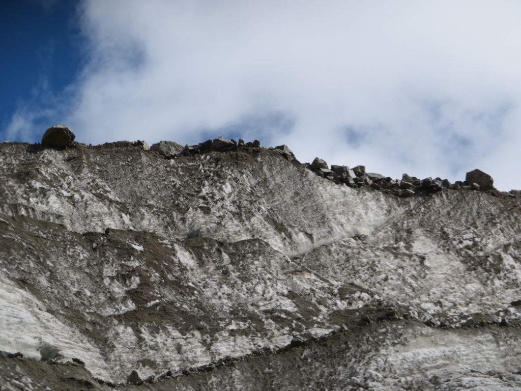 Rocks on rim of Shkhara glacier - © William Mackesy