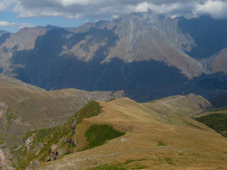 Khevi, Kazbegi and the Military Highway : Gergeti walk - long ridge down to Tsminda Sameba church - © William Mackesy