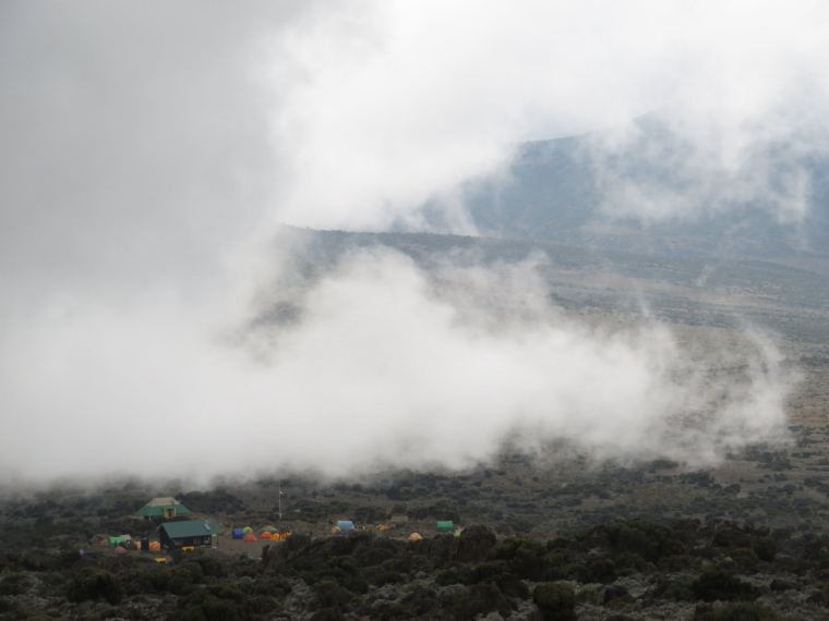 Lemosho and Shira Routes  : Day 3,  Shira 2 under cloud coming over plateau edge - © William Mackesy