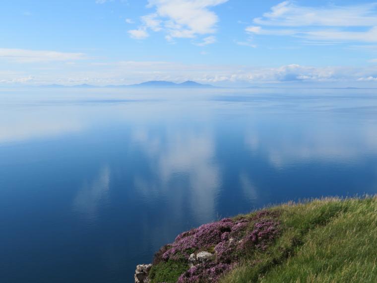 United Kingdom Scotland Isles Skye, Isle of Skye, Outer Hebrides from Ramasaig Cliff, stillest sea ever, Walkopedia