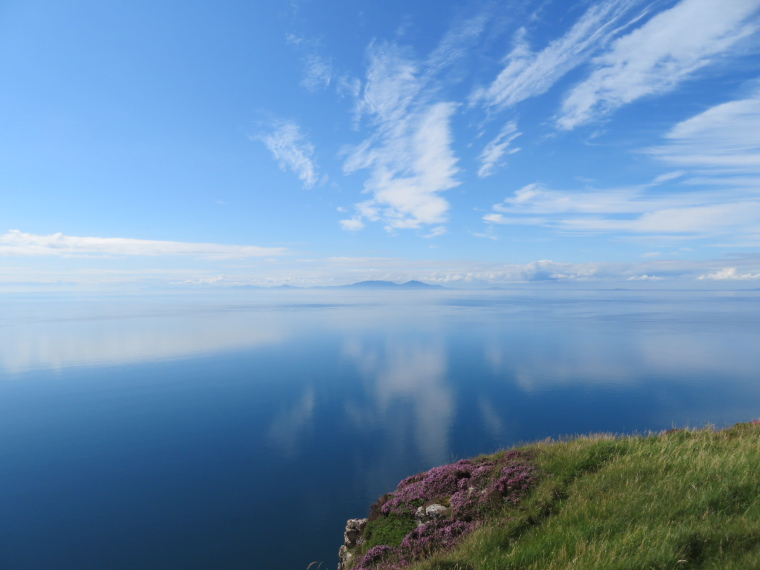United Kingdom Scotland Isles Skye, Isle of Skye, Outer Hebrides from Ramasaig Cliff, stillest sea ever 2, Walkopedia