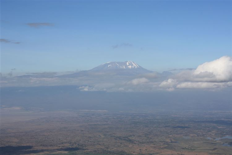Mt Meru: Kilimanjaro across the plain - © Hugo Macklin