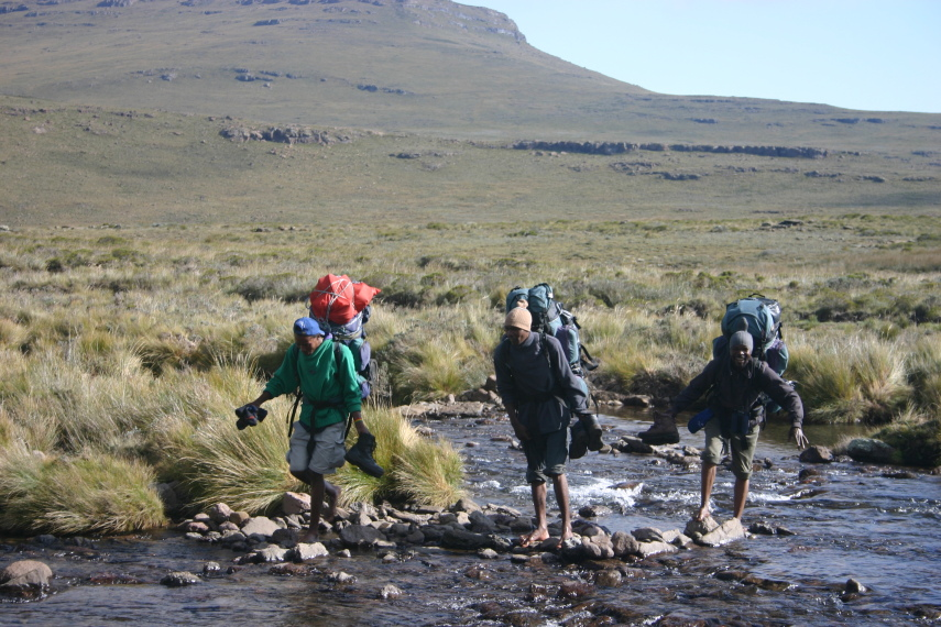 South Africa Drakensberg, North Drakensberg Traverse, Our porters crossing a stream, Walkopedia