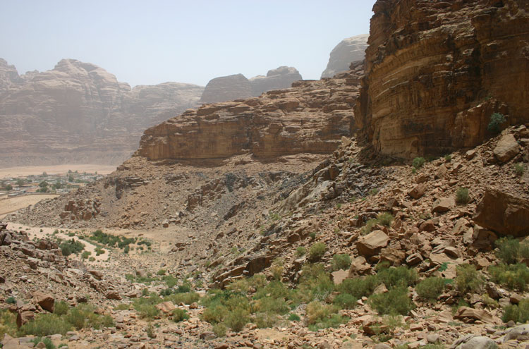 Looking back down the valley, out to Wadi Rum - © William Mackesy