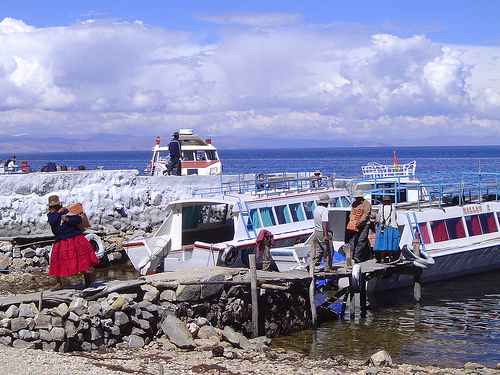 Locals on dock, Isla del Sol - © By Flickr user ydnammmm