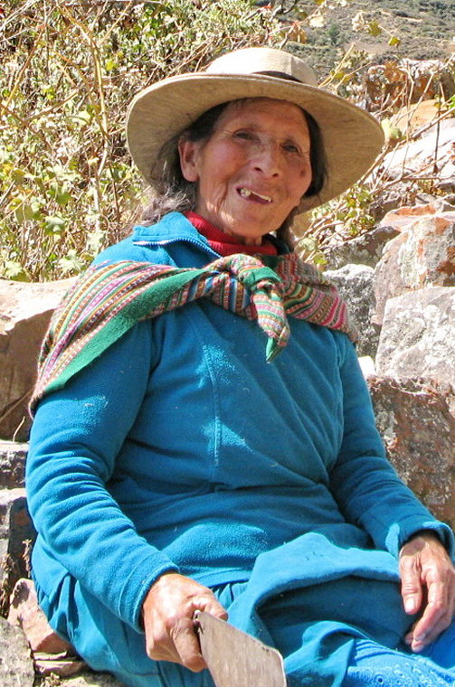 Huayhuash Circuit: Woman in blue w machete outside Llamac-Kestrel - © Charles Bookman