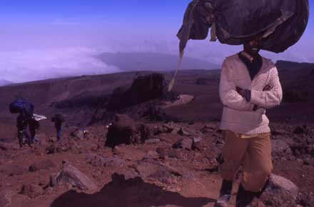 Mount Kilimanjaro : Porters Leaving Lava Towers - © Arabella Cecil