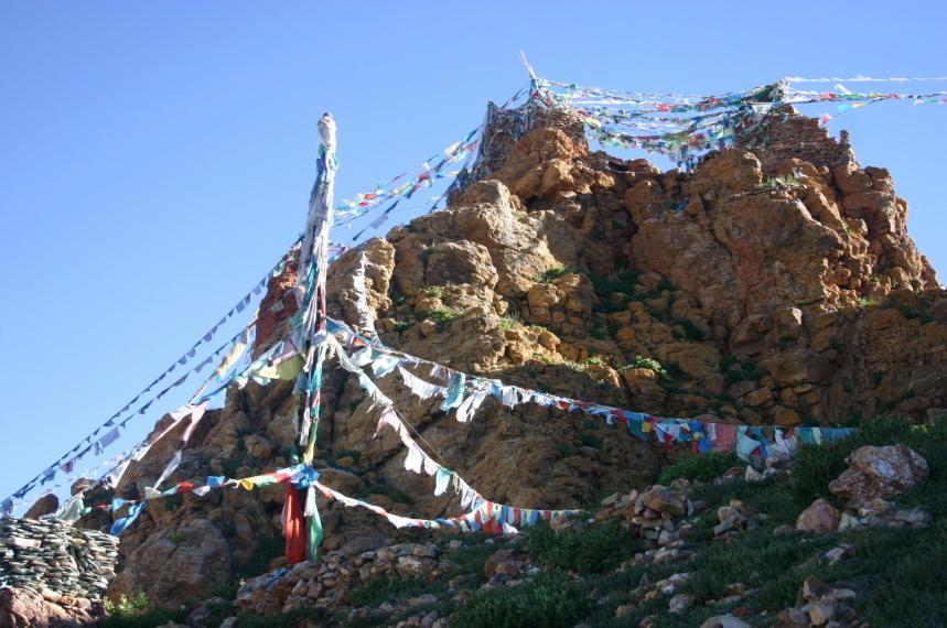 China Tibet, Lake Manasarovar, Prayer flags above cliff-top monastery, Walkopedia