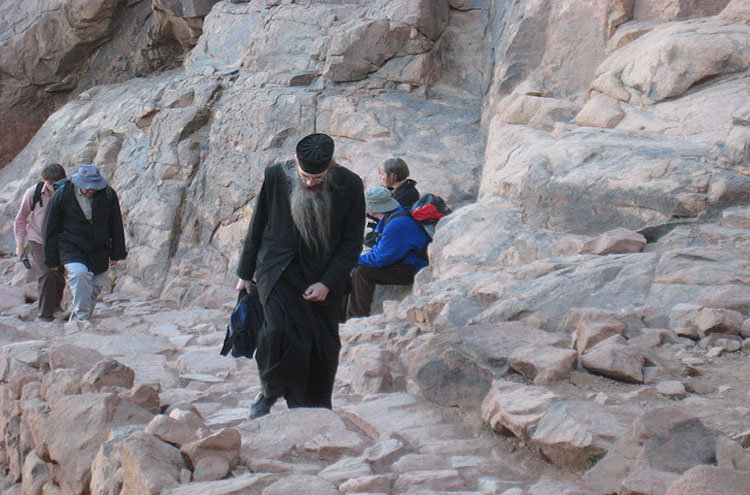 A priest walking up Mount Sinai - © From Flickr user Gloria-Euyoque