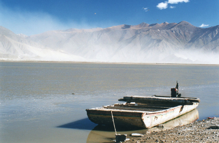 Ferry on Yarlung, looking across to Samye hills - © William Mackesy